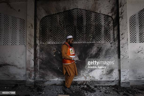 Pakistani security forces collect evidences from the site of a suicide blast at a Shiite Mosque in Pakistans northwestern Peshawar on February 13...