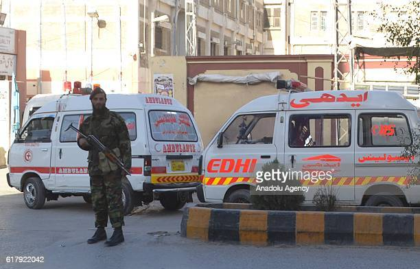 Pakistani security forces member stands guard in Quetta Pakistan on October 25 after militants attacked the training college At least 61 cadets and...