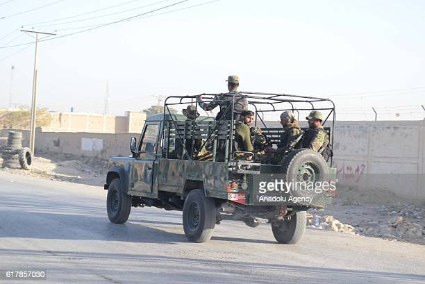 Pakistani security forces patrol outside the Balochistan Police Training College in Quetta on October 24 after militants attacked the training...