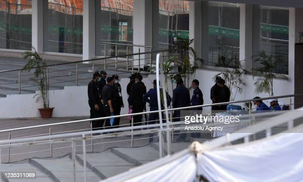 Pakistani security forces personnel are seen in the cricket stadium following the cancellation of cricket series between Pakistan and New Zealand, in...