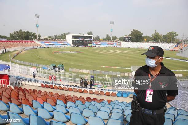Pakistani security forces personnel is seen in the cricket stadium following the cancellation of cricket series between Pakistan and New Zealand, in...