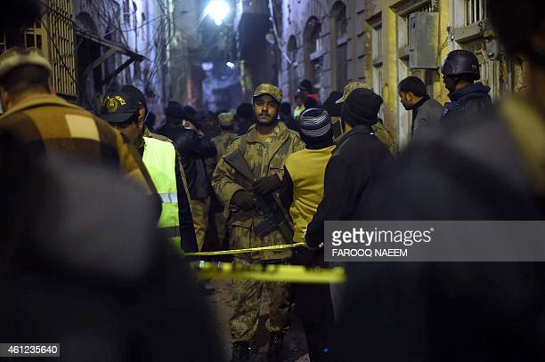 Pakistani security forces secure the site of a blast in Rawalpindi on January 9 2015 A powerful explosion struck a Shiite mosque in Pakistan's...