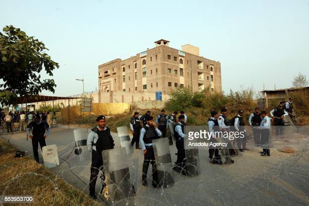 Pakistani security forces stand guard during former Pakistani Prime Minister Nawaz Sharif's hearing in front of accountability court in Islamabad...