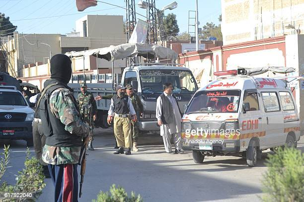 Pakistani security forces stand guard in Quetta Pakistan on October 25 after militants attacked the training college At least 61 cadets and guards...