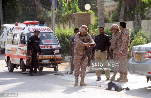 Pakistani security forces take measures outside the Chinese consulate after an armed attack in Pakistans southern port city of Karachi on November 23...
