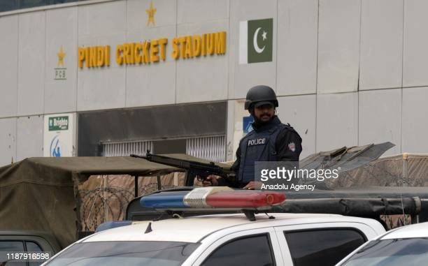 Pakistani security forces take security measures during the the first day of the play of 1st Test cricket match between Pakistan and Sri Lanka at...