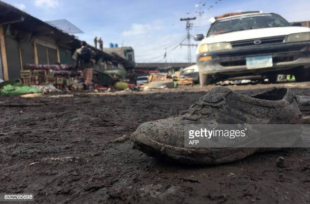 TOPSHOT Pakistani security officals inspect the bomb explosion site at a vegetable market in Parachinar city the capital of Kurram tribal district on...