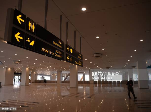 A Pakistani security official from the Airport Security Force walks through the newlybuilt Islamabad International Airport ahead of its official...