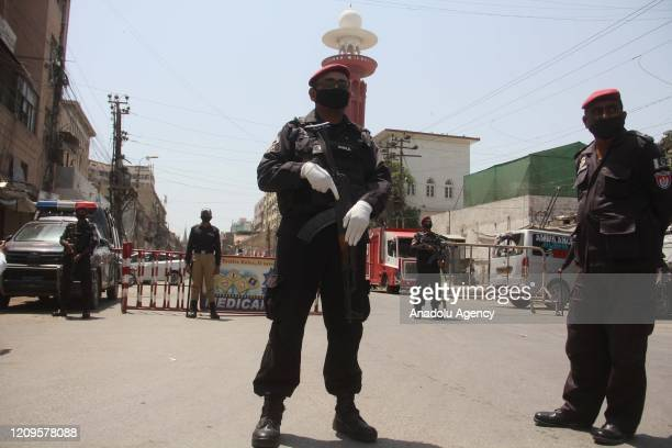 Pakistani Security official stands guard at closed market during a lockdown at Sindh province due to coronavirus pandemic in Karachi, Pakistan on...