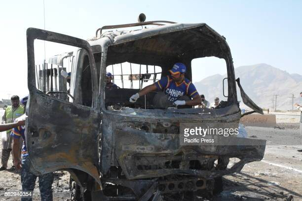 QUETTA BALUCHISTAN PAKISTAN Pakistani security officials and rescue workers are inspecting the scene of Roadside bomb blast A suicide bomber targeted...