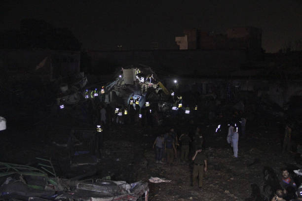 Pakistani security officials and rescue workers gather on site of bomb blast in LahoreAugust 072017An explosion injured at least 34 people late...