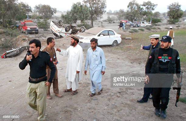 Pakistani security officials and residents gather at the site after a bomb blast in Bannu on November 26 2015 At least two people were killed when a...