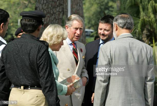 Pakistani security officials are introduced to Britain's Prince Charles and his wife Camilla Duchess of Cornwall by a British official upon their...