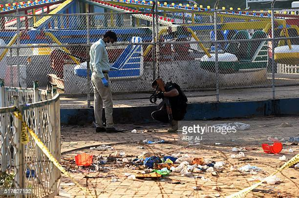 Pakistani security officials collect evidence at the cordonedoff site of the March 27 suicide bombing in Lahore on March 28 2016 The toll from a...