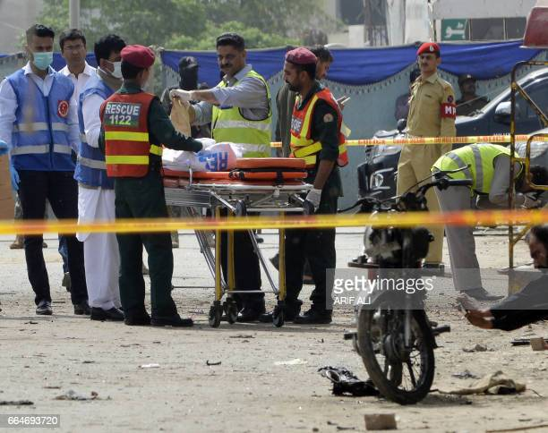 Pakistani security officials collect evidence from the scene of a blast in Lahore on April 5 2017 At least four people have been killed in a blast...