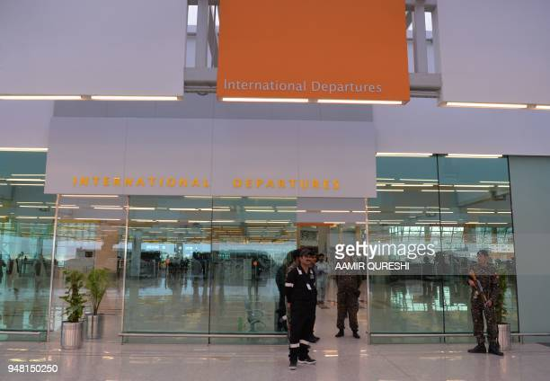 Pakistani security officials from the Airport Security Force stand guard at the newlybuilt Islamabad International Airport ahead of its official...