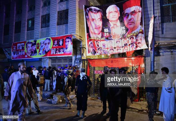 Pakistani security officials gather at the site of a suicide bombing at an election rally in Peshawar on July 10 2018 A suicide bombing at an...
