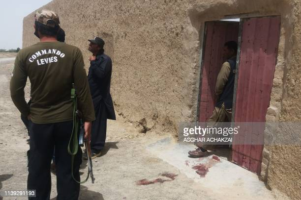 TOPSHOT Pakistani security officials gather at the site of an attack by gunmen on a polio vaccination team in the town of Chaman in Balochistan...