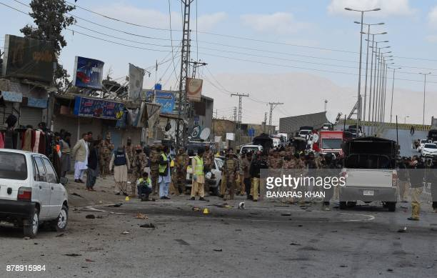 Pakistani security officials inspect the site of a suicide bombing in Quetta on November 25 2017 At least four people died and 19 others were injured...