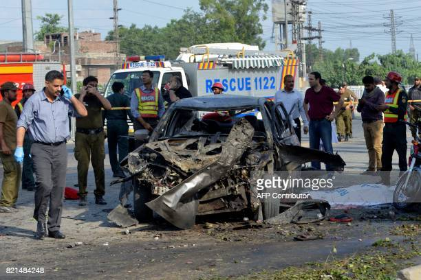 Pakistani security officials inspect the site of an explosion in Lahore on July 24 2017 An explosion killed at least 15 people and injured 20 in...