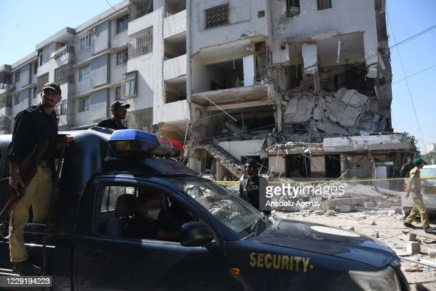 Pakistani security officials inspect the site of the explosion in Karachi, Pakistan on October 21, 2020. At least 5 dead and 23 injured in an...