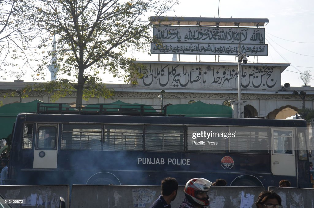 Pakistani security officials stand guard alert at shrine of Saint Syed Ali bin Osman AlHajvery popularly known as Data Ganj Bakhsh during friday...