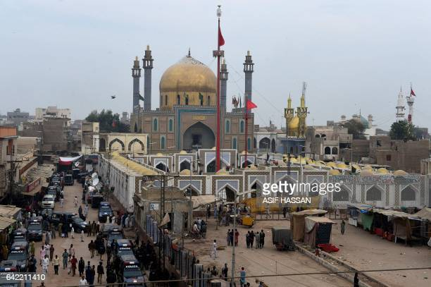 Pakistani security personnel deploy outside the shrine of 13th century Muslim Sufi saint Lal Shahbaz Qalandar a day after a bomb blew up at the...