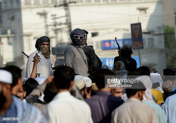 Pakistani security personnel escort Sunni Muslim leaders during the funeral prayers of Mufti Amanullah from the hardline Sunni organisation Ahle...