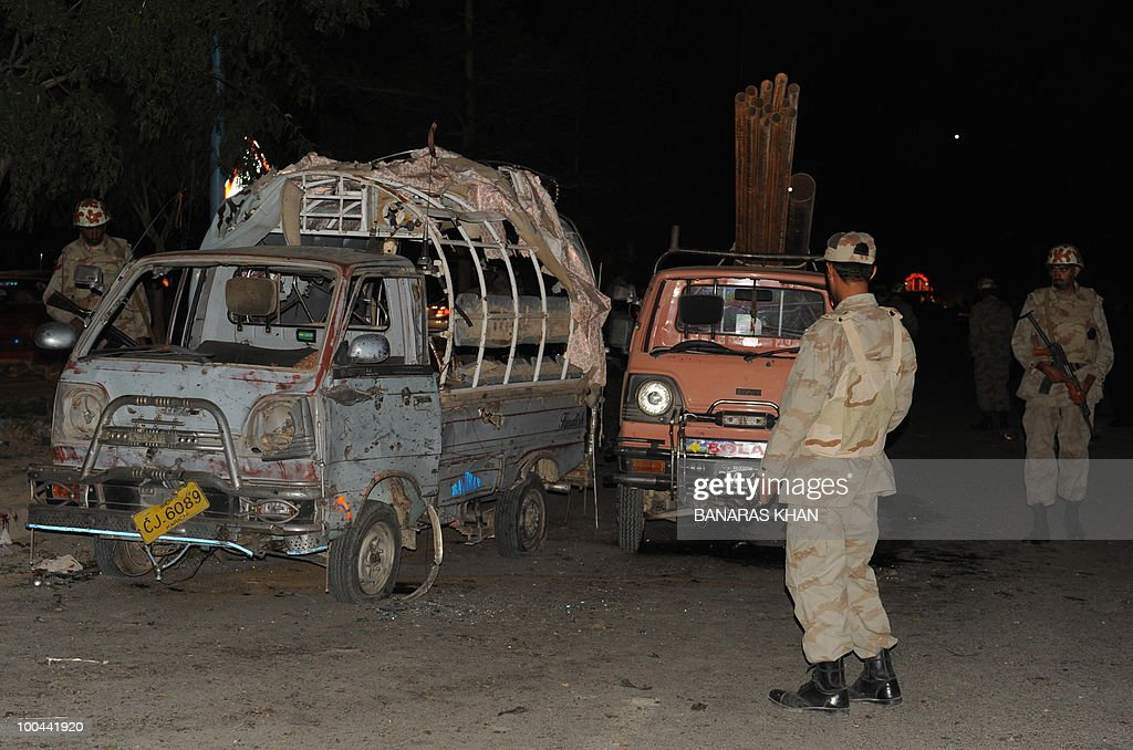 Pakistani security personnel gather as they check damaged cars at the bomb blast site in Quetta on May 24, 2010. Two people were killed and a dozen wounded, including several wedding party guests, when a bomb exploded in a rickshaw in Pakistan's southwestern Baluchistan province, police said. AFP PHOTO/Banaras KHAN