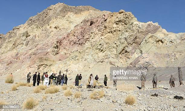 Pakistani security personnel gather at the site of a bomb blast in Quetta on January 2 2017 At least four security personnel were injured when a...