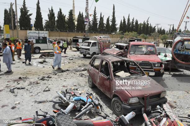 TOPSHOT Pakistani security personnel gather at the site of a suicide attack near a polling station in Quetta on July 25 2018 At least 30 people were...