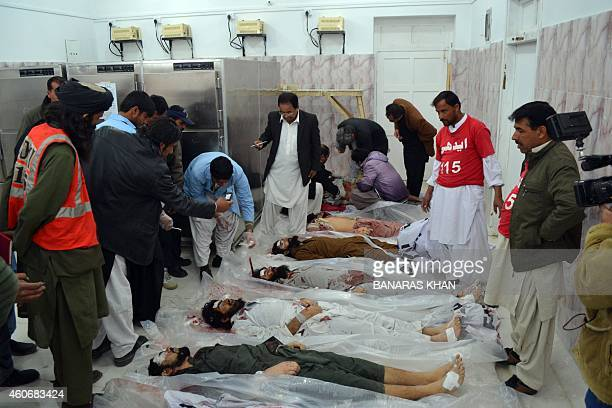 Pakistani security personnel identify the bodies of militants killed in operation at a hospital in Quetta on December 19 2014 At least seven...