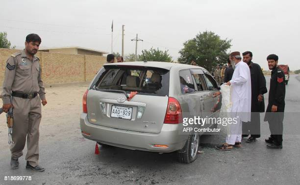Pakistani security personnel inspect a bulletriddled vehicle belonging to a Shiite Muslim after an ambush by gunmen on a highway in Choto a town some...