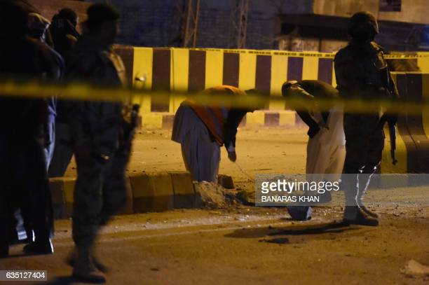 Pakistani security personnel inspect the site of an explosion in Quetta on February 13 2017 In Pakistan's southwestern province of Balochistan two...