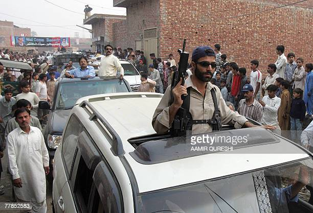Pakistani security personnel lead a convoy of the former Pakistani prime minister Benazir Bhutto in Lahore 12 November 2007 following her visit to...