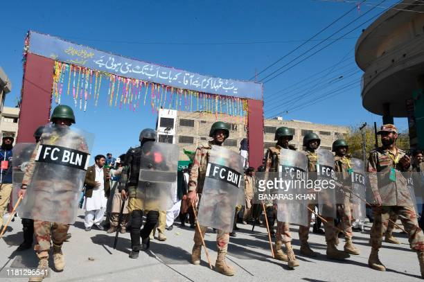 Pakistani security personnel lead aMuslims procession to celebrate the birthday of Prophet Mohammed, in Quetta on November 10, 2019. - The birthday...