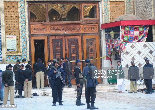 Pakistani security personnel stand guard at the 13th century Muslim Sufi shrine of Lal Shahbaz Qalandar a day after a bomb attack in the town of...