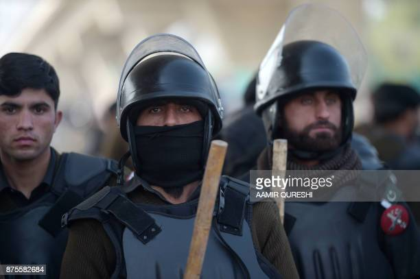 Pakistani security personnel stand guard during a protest by activists from the TehreekiLabaik Yah Rasool Allah Pakistan religious group in Islamabad...