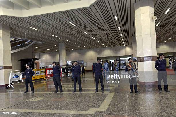 Pakistani security personnel stand guard during the arrival of Indian Prime Minister Narendra Modi at the Allama Iqbal International Airport in...