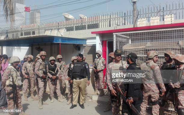 Pakistani security personnel stand outside the Chinese consulate after an attack in Karachi on November 23 2018 At least two policemen were killed...