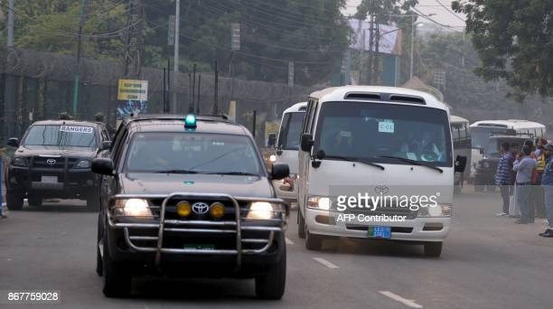 Pakistani security vehiclez escort the buses of the Sri Lankan and Pakistani cricket teams as they arrive at the Gaddafi Cricket Stadium in Lahore on...