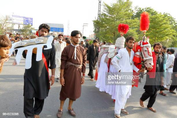 pakistani shia muslims march with symbolic horse of hazrat imam hussain during a muharram precession - depression sadness stock pictures, royalty-free photos & images
