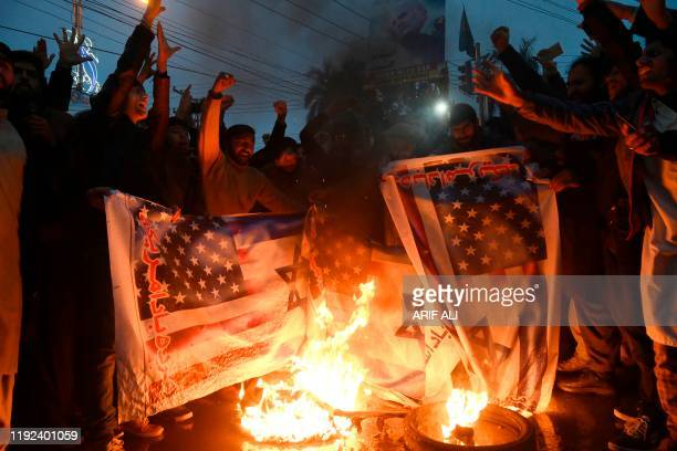 Pakistani Shiite Muslim burn US and Israeli flags in a protest against the killing of top Iranian commander Qasem Soleimani in the US strike in Iraq,...