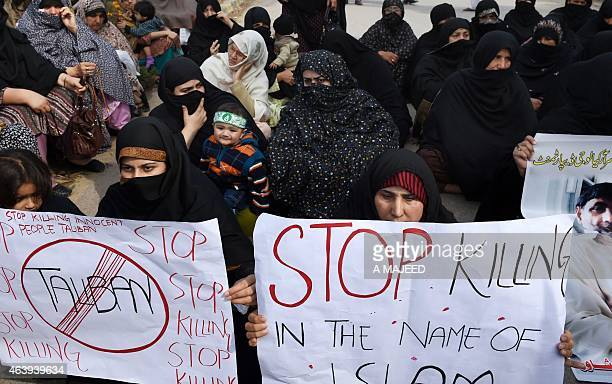 Pakistani Shiite Muslim demonstrators hold posters during a protest against a suicide bomb attack on a Shiite mosque in Peshawar on February 20 2015...