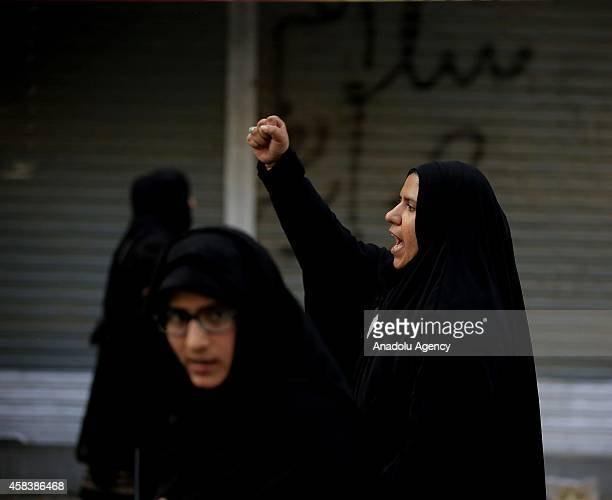 Pakistani Shiite Muslim devotee woman shouts slogans during the mourning procession of Ashura on the 10th day of holy month of Muharram, the first...