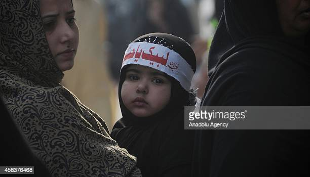 Pakistani Shiite Muslim devotees attend the mourning procession of Ashura on the 10th day of holy month of Muharram the first month of Islamic...