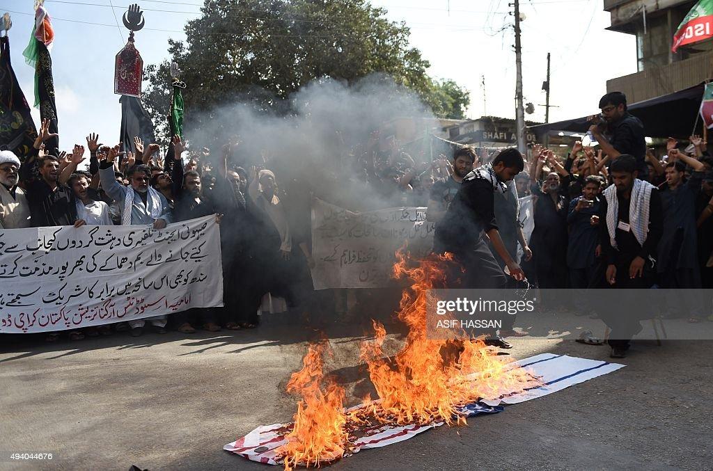 Non Muslim Perspective On The Revolution Of Imam Hussain: Pakistani Shiite Muslim Devotees Burn An Israeli And US