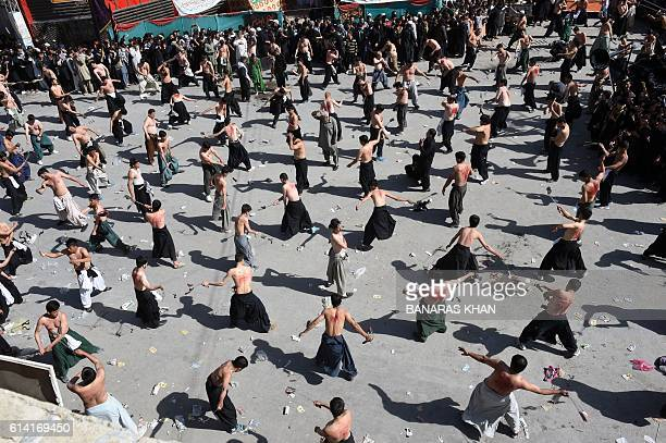 Pakistani Shiite Muslim flagellate during a Ashura procession in Quetta on October 12 2016 Ashura is a period of mourning in remembrance of the...
