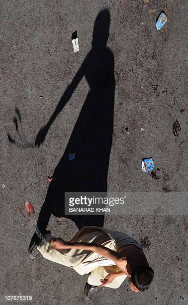 A Pakistani Shiite Muslim flagellates himself during an Ashura procession in Quetta on December 17 2010 Pakistan imposed blanket security December 17...