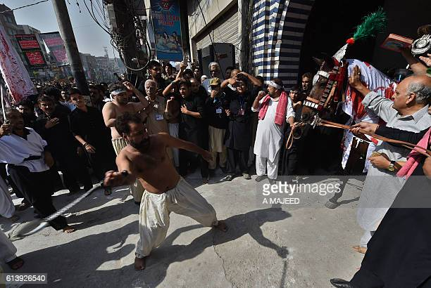 A Pakistani Shiite Muslim flagellates himself during the Ashura procession in Peshawar on October 11 2016 The Islamic month of Muharram marks the...